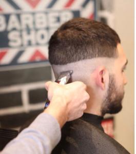 buzz cut at barbershop